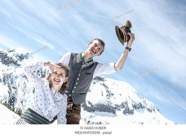 Happy couple in the snowy mountains, Salzburg State, Austria