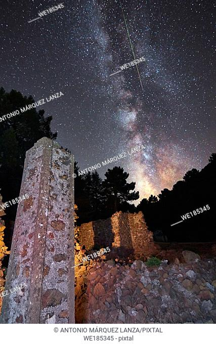 Milky way in a ruins with a meteorite crossing it