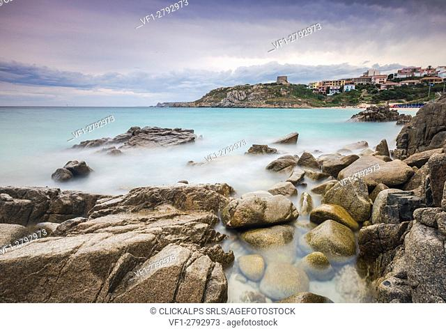 Storm clouds frame the village overlooking the turquoise sea Santa Teresa di Gallura Province of Sassari Sardinia Italy Europe