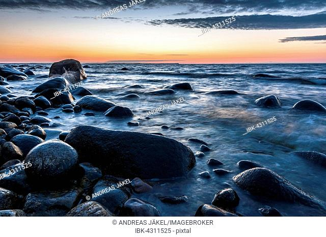 Stones, boulders on the beach at sunset, Baltic Sea, Jasmund National Park, Jasmund peninsula, Rügen Island, Mecklenburg Vorpommern, Germany