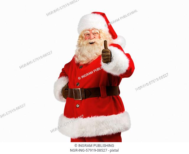 Santa Claus standing isolated on white background and thumbs up
