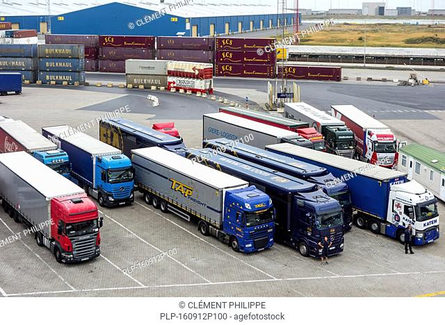 Containers and trucks waiting to board roll-on/roll-off / roro freight ship in the port of Zeebrugge, Belgium
