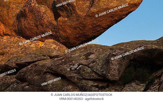Rock and moon at dark in La Prediza
