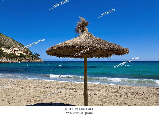 Straw beach umbrella, Cala Canyamel, Mallorca, Spain