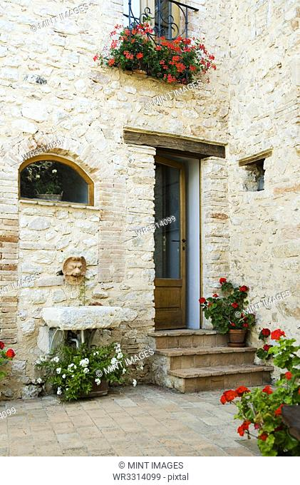 Flowerpots outside stone apartment
