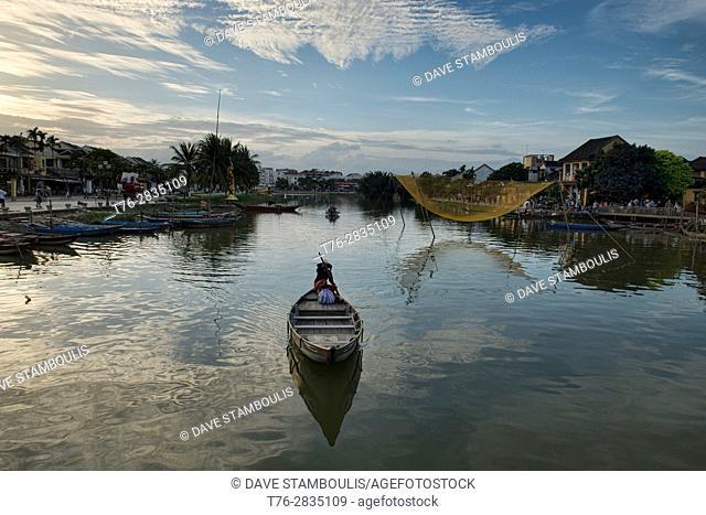 Lone paddler and fishing net on the Thu Bon River, Hoi An, Vietnam