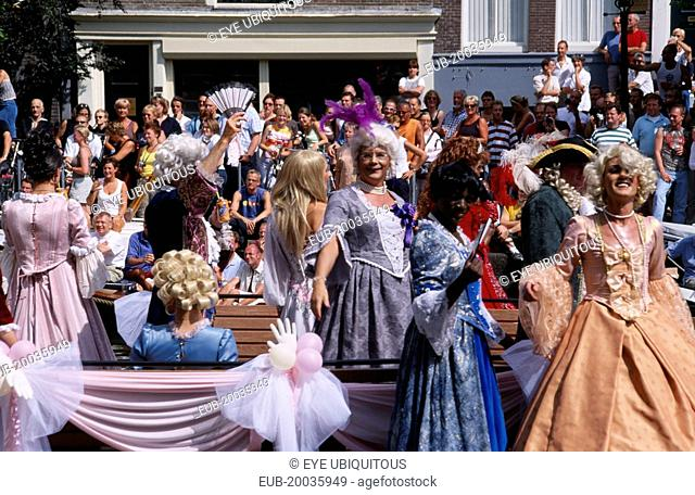 Gay Pride canal parade with men dressed in historical womens cotumes