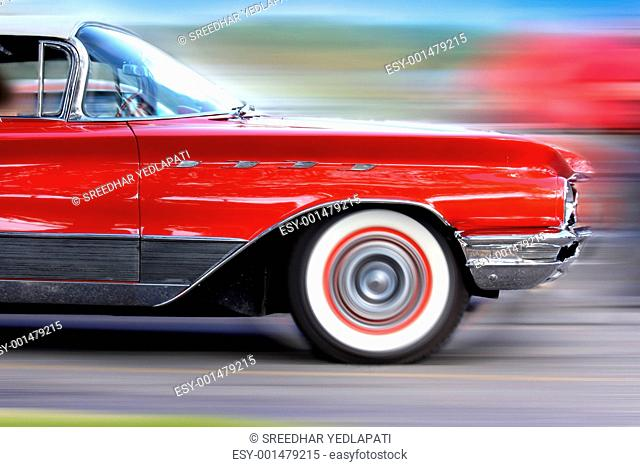 Fast moving classic red car