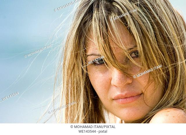 Close up of beautiful blonde woman hair covering face