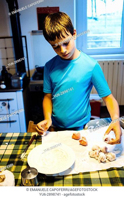 12 year old boy preparing food in the kitchen