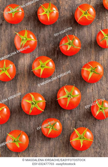 Fresh tomatoes on vintage wooden table