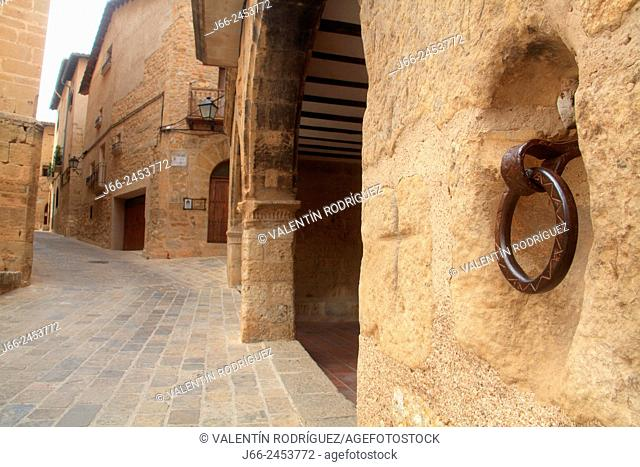 Belmonte de San José street with the facade of the town hall building firtly. Mezquín region. Low Aragon. Teruel. Spain