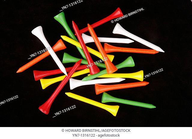close up view of a pile of colorful golf tees