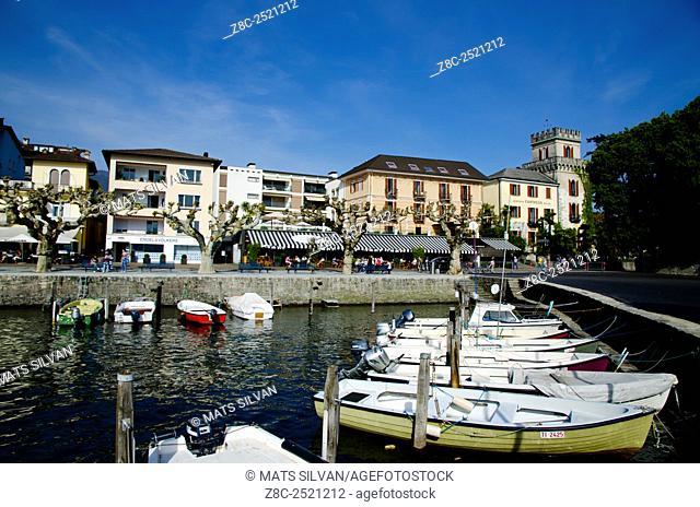 Small harbor on an alpine lake Maggiore with a village in Ascona, Switzerland