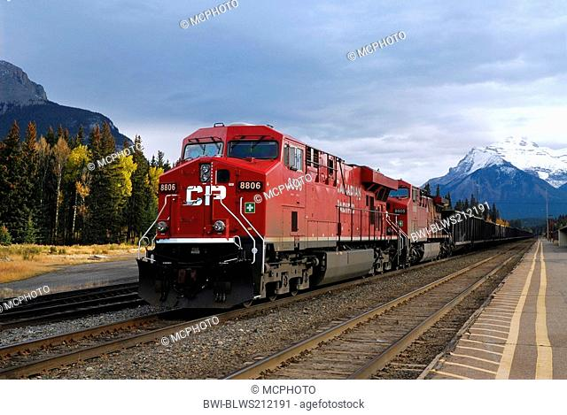 red freight train at Banff station Alberta, USA, Colorado, Rocky Mountains