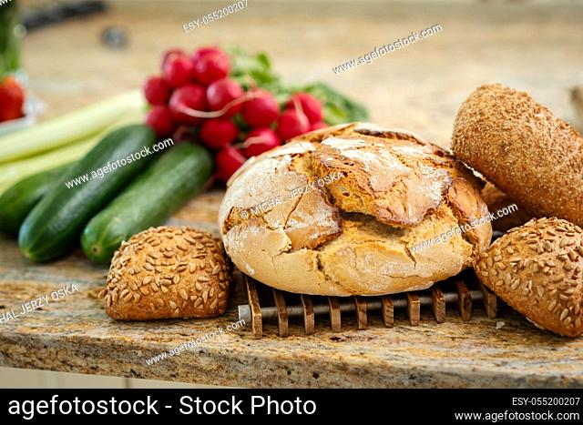 fragrant crunchy bread on the table with fresh and colorful vegetables