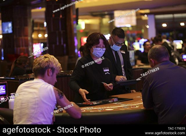 Las Vegas, NV - June 4, 2020: Dealers wearing masks during the Grand Re-Opening of Red Rock Casino Resort & Spa at 12:01 AM on June 4, 2020 in Las Vegas, Nevada