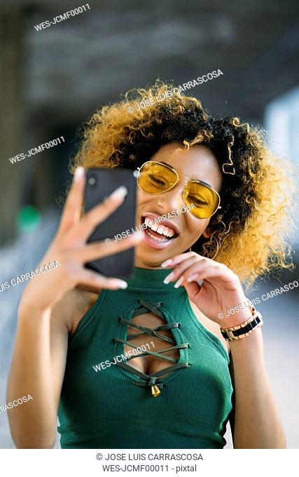 Portrait of fashionable young woman using smartphone
