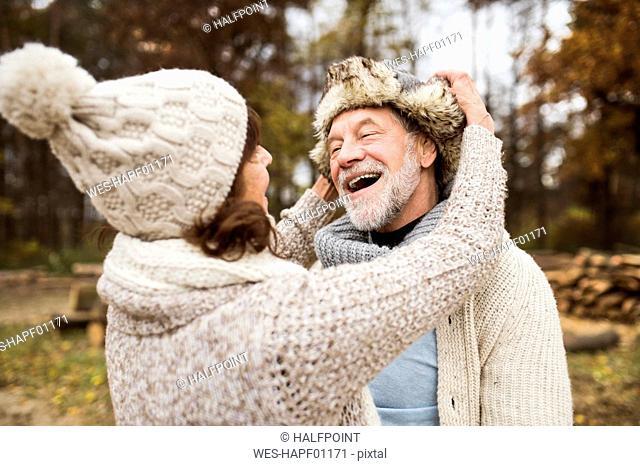 Happy senior couple in autumnal nature