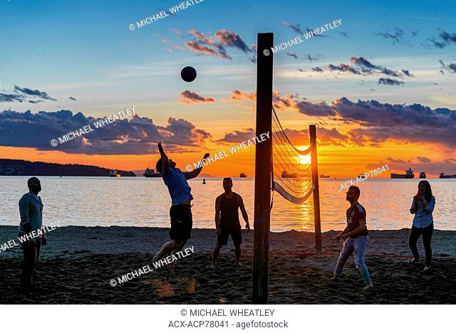 A game of beach volleyball at sunset, English Bay Beach, Vancouver, British Columbia, Canada