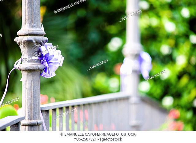 Decorative bow on iron pole of bridge
