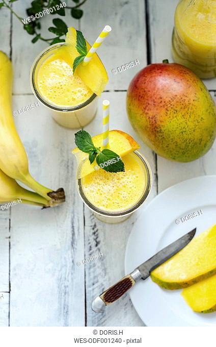 Two glasses of mango banana smoothie