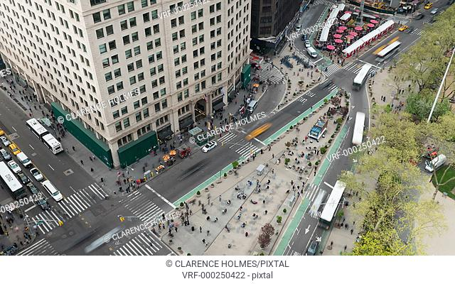 NEW YORK - MAY 7: (Time-lapse/Zoom-in) Traffic and pedestrians move through Madison Square at the intersection of 5th Avenue and Broadway at 24th Street on May...