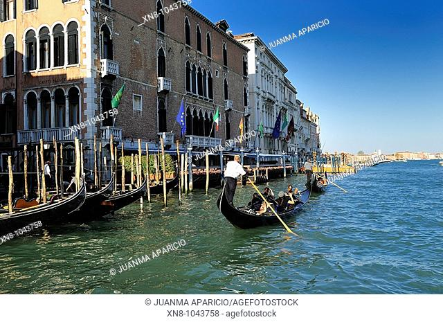 Two gondolas carrying tourists along the Grand Canal Venetian