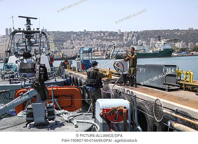 07 August 2019, Israel, Haifa: Soldiers work on the surface of a military ship sails during a multi military forces drill