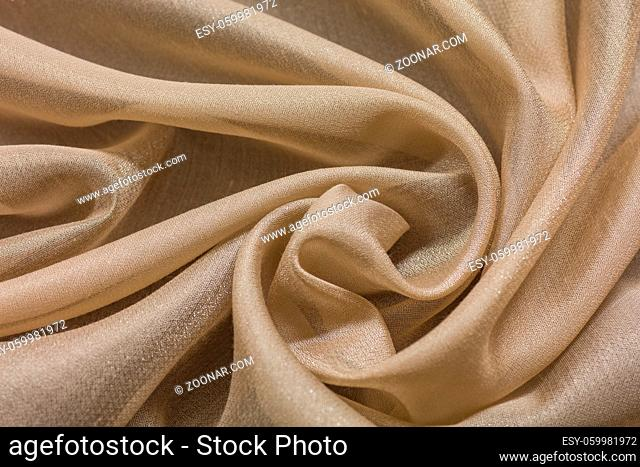 Shiny cloth background with beige vial textile