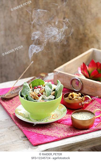 Spinach salad with gorgonzola, redcurrants, walnuts, honey and poppyseed dressing