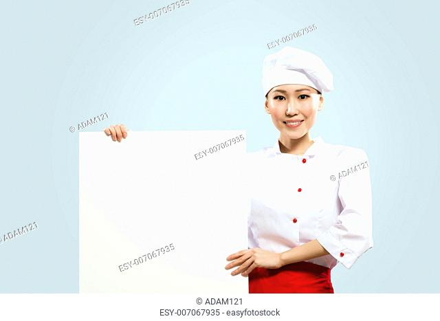 Asian female chef holding a white poster for the text