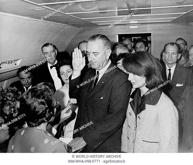 Vice President Lyndon Johnson, sworn in as President following the assassination of John F Kennedy November 22 1963. He is watched by Jacquie Kennedy the widow...