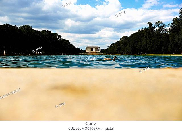 View across reflecting pool to Lincoln Memorial, Washington DC, USA