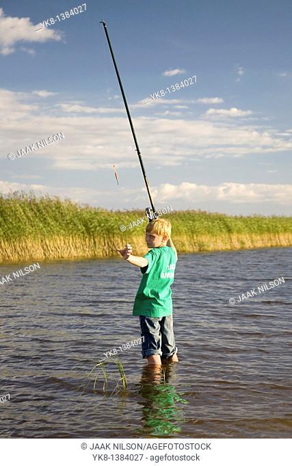 Teenage Boy Fishing by Lake Võrtsjärv in Estonia