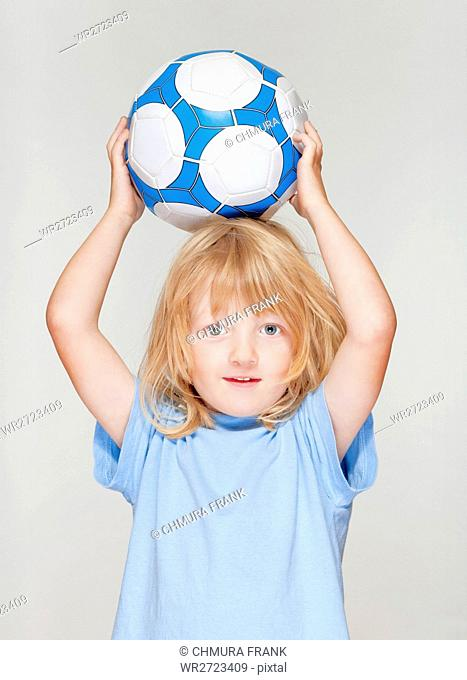 active, background, ball, blond, blue, boy, Caucasian, child, childhood, cute, football, fun, game, hand, hold, isolated, kid, little, male, one, people, person