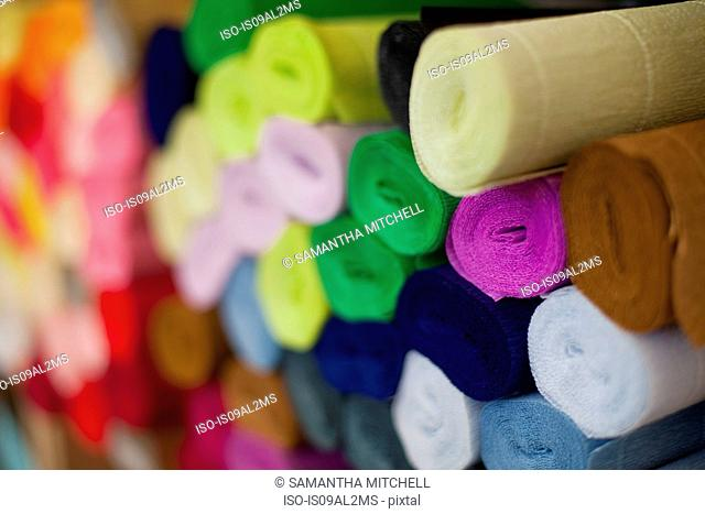 Still life of multi colored crepe paper rolls
