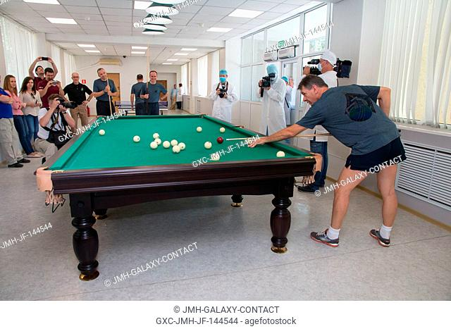 At the Cosmonaut Hotel crew quarters in Baikonur, Kazakhstan, Expedition 52-53 crewmember Paolo Nespoli of the European Space Agency tries his hand at billiards...