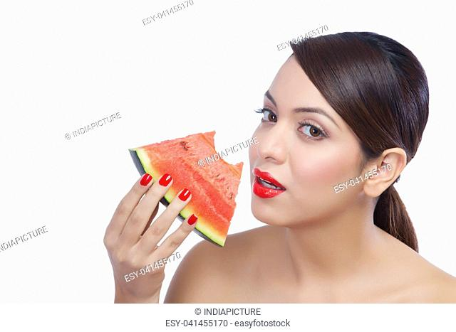 Portrait of a woman eating a watermelon