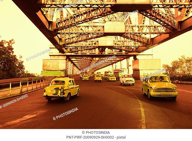 Taxis on a bridge, Howrah Bridge, Kolkata, West Bengal, India