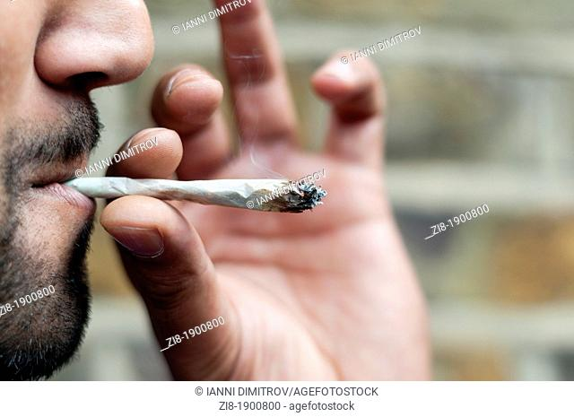 Man smoking cannabis-close-up