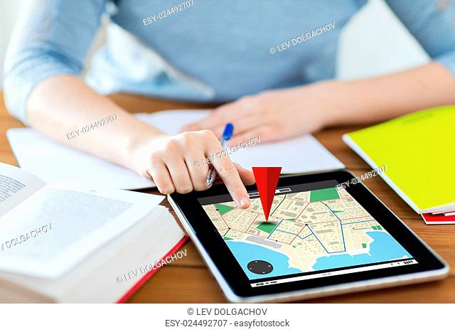 business, location, navigation, technology and internet concept - close up of student woman with gps navigator map on tablet pc computer and notebook at home