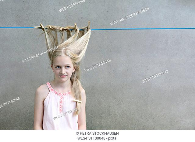 Blond girl's hair drying on clothesline