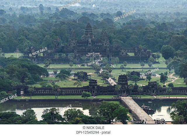 Aerial view of Angkor Wat amongst trees; Siem Reap, Siem Reap Province, Cambodia