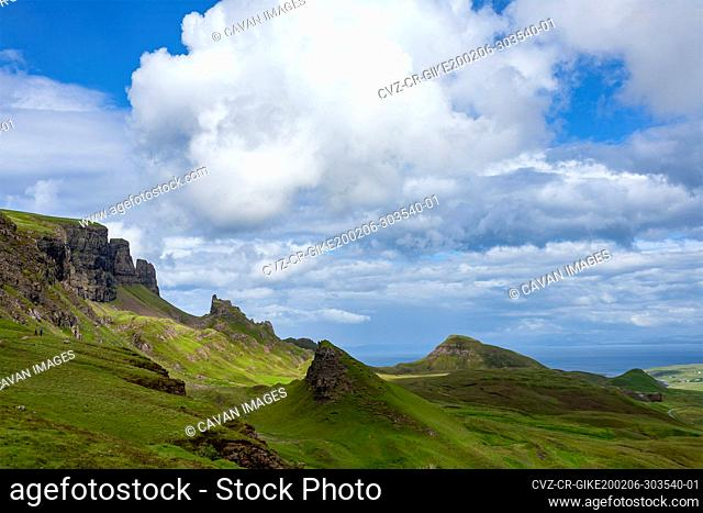 Green Fields and Blue Sky with Clouds in Quiraing Isle of Skye Scotlan