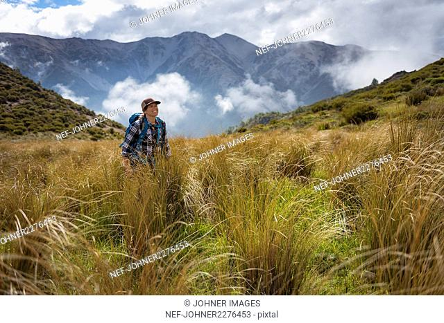 Young woman hiking in mountains
