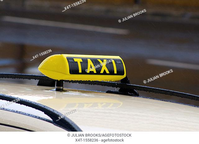 Taxi sign in the rain, ready for hire  Berlin,Germany