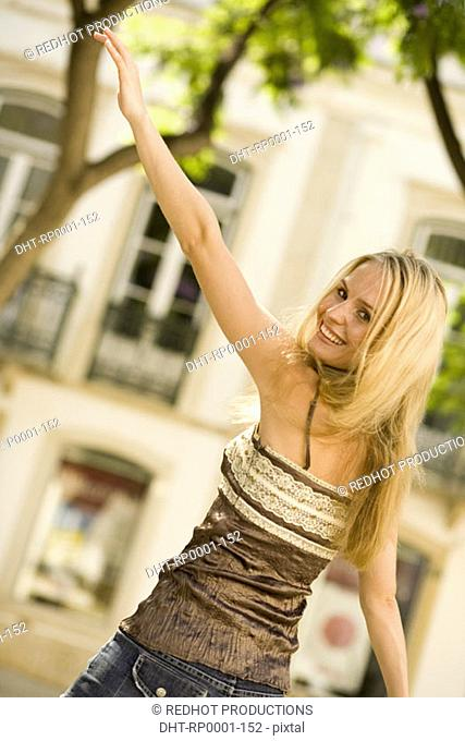 Young woman waving