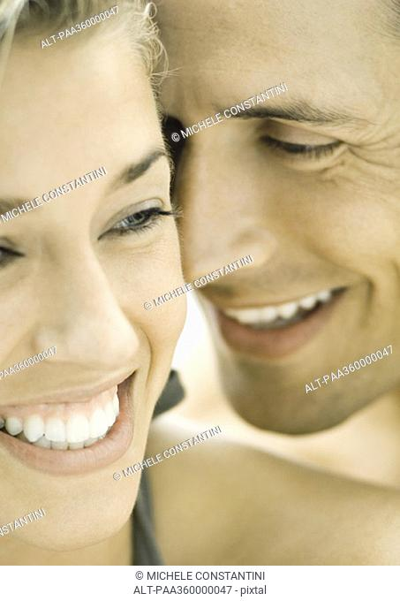 Couple smiling, faces close-together