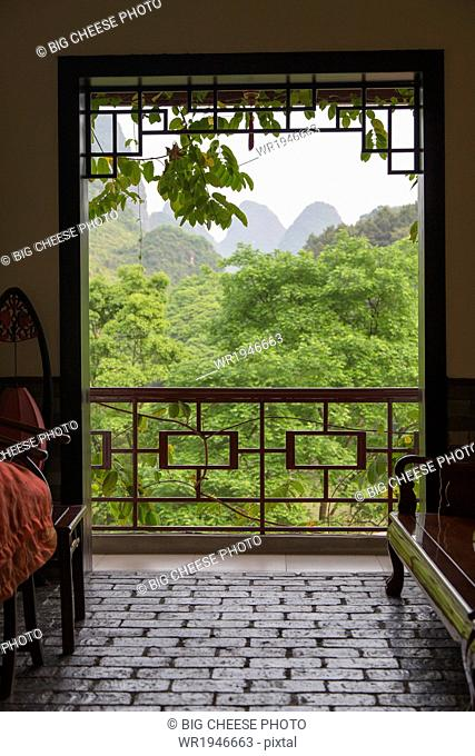View of the Karst mountains from a hotel interior, Yangshuo, China